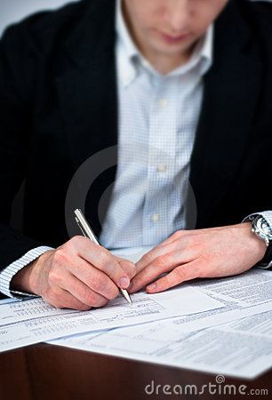 Business men filling out documents with pen.