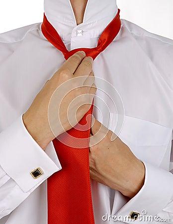 Business men is fixing his tie