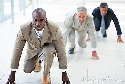 Business men in position for a race
