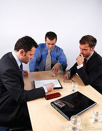 Business men reading a contract