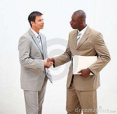 Business men shaking hands with eachother