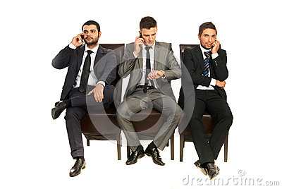 Business men talking by phones