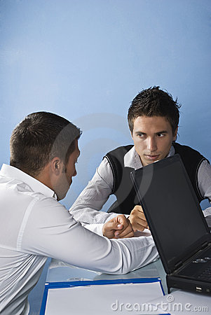 Business men telling a secret