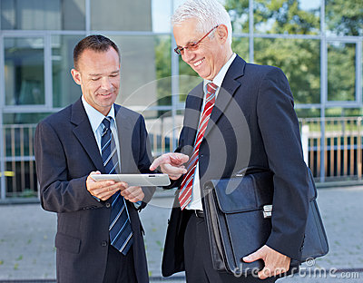 Business men using a tablet