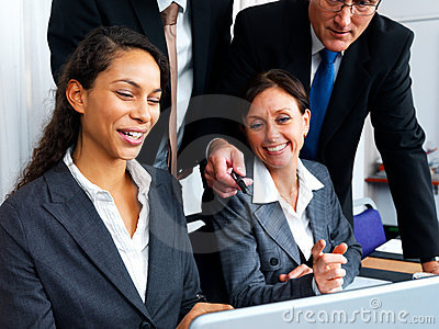 Business men and women working together in office