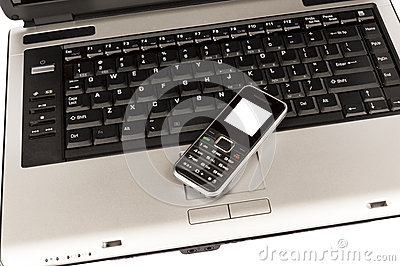 Business Mobile Phone On Laptop