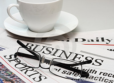 Business newspaper and a cup of coffee