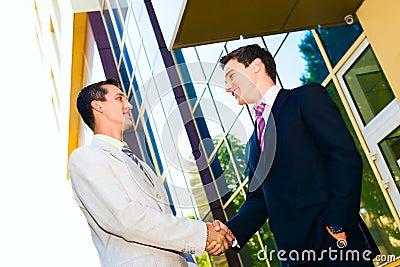Business partner shaking hands