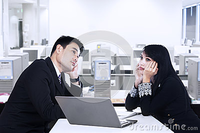 Business partner thinking in office