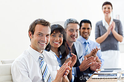Business partners applauding a presentation
