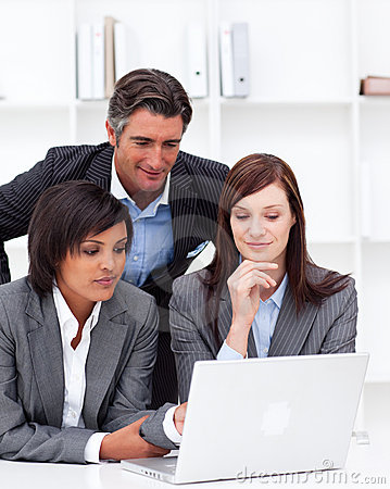 Business partners working at a computer