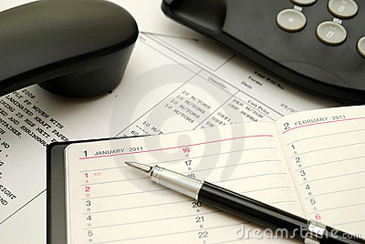 Business pen on diary or personal planner