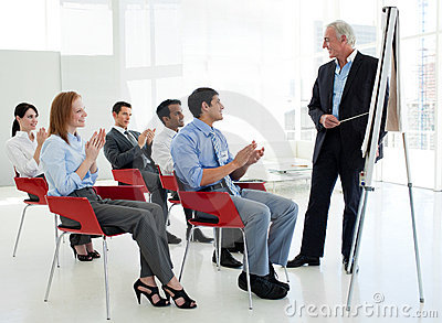 Business people applauding at a conference