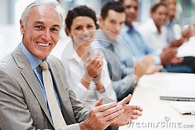 Business people applauding in presentation room