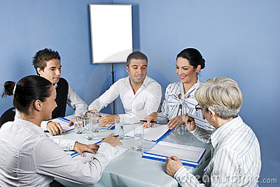 Business people around a table at meeting