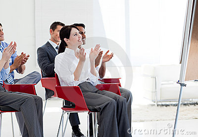 Business people clapping at a conference