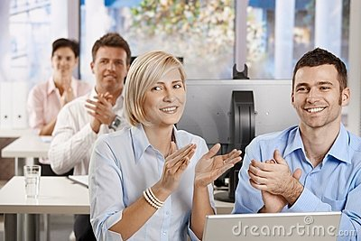 Business people clapping on training