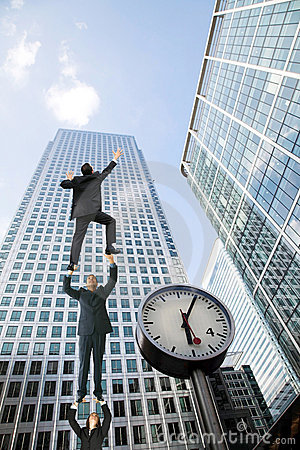Business people climbing a building