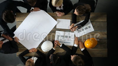 Business people with construction blueprint stock video video of business people with construction blueprint stock video video of hardhat discussion 98267491 malvernweather Images