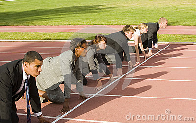 Business People Crouching at Track Starting Line