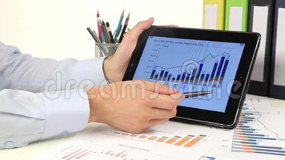 Business people developing a business project and. Analyzing market data information on a modern digital tablet computer