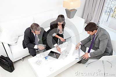 Business people at financial meeting.