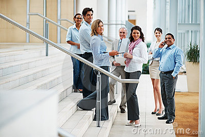 Business people in a group at the staircase