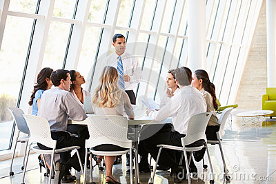 Business People Having Board Meeting In Modern Office