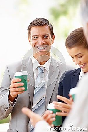Business people having coffee during their break