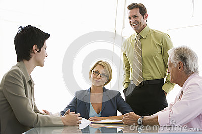 Business People Having Discussion At Conference Table