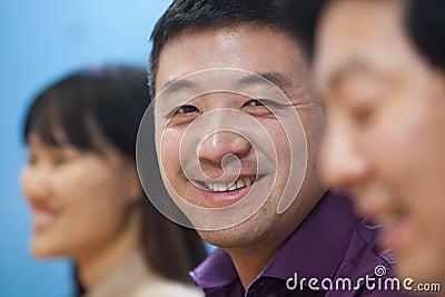 Business People Having Meeting in Board Room, Smiling