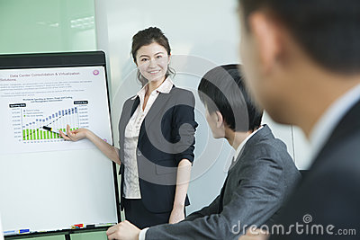 Business people having meeting, doing a presentation