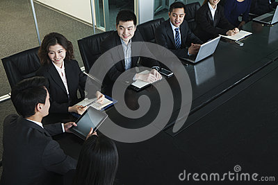 Business people having meeting, sitting at conference table
