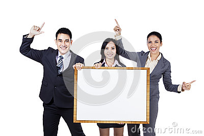 Business people holding empty signboard