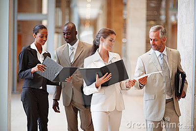 Business people holding files at the hallway