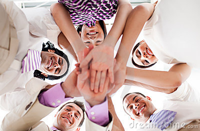 Business people holding hands together in a circle