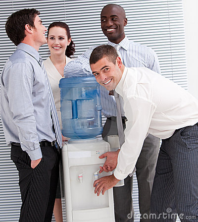 Business people interacting at a water cooler