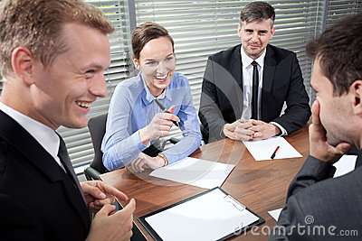 Business people laughing during business meeting
