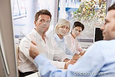 Business people listening presentation