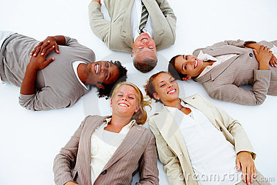 Business people lying down demonstrating unity
