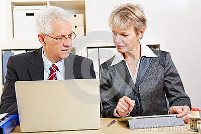 Business people in office comparing