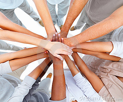 Business people overlapping hands to show unity