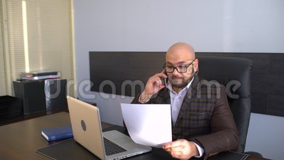 Business, people, paperwork and technology concept - businessman with laptop computer and papers working at office. 4 k stock video footage