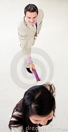 Business people passing a baton
