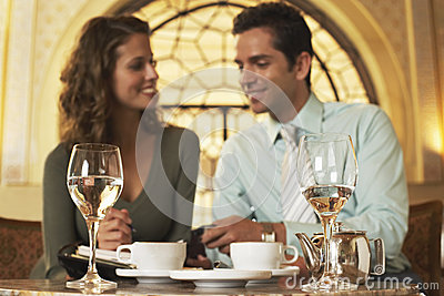 Business People Planning Schedule In Restaurant