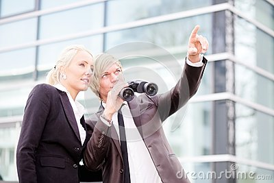Business people pointing binoculars