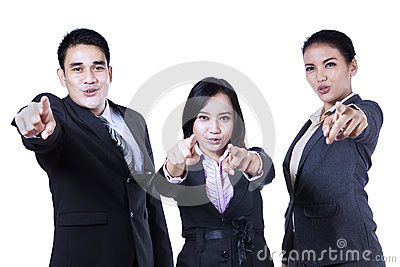 Business people pointing at you