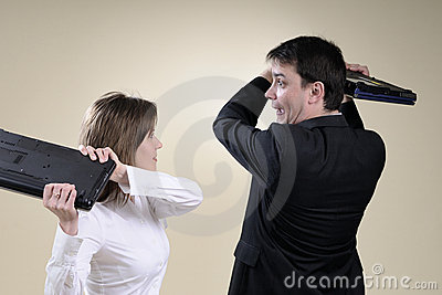 Business people preparing to fight with laptops
