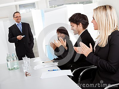 Business people at presentation applauding
