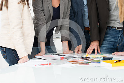 Business people selecting material for a project